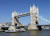London: Tower bridge and tour boat - Thames river - photo by K.White