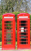 Warrington, Cheshire, England, UK: twin Telephone Boxes, Sankey Street - public phones - phone booths - quintessential British red phone box, designed by Sir Giles Gilbert Scott, English architect - K6 - photo by D.Jackson