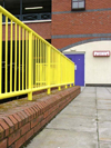 UK - England - Ellesmere Port: yellow railings and purple door, Cheshire Oaks Designer Outlet Centre (photo by David Jackson)