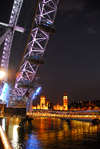 London: British Airways London Eye and the Parliament - Thames river - at night - photo by M.Torres