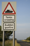Lulworth to Wareham road, Dorset, England: warning sign for tanks crossing and sudden gunfire - photo by I.Middleton