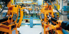 Cowley, Oxfordshire, South East England: robots in a car factory - German KUKA Industrial robots - Industrial Robotics in car production - photo by A.Bartel