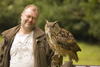 Exmoor NP, Somerset, South West England, UK: visitor with great horned owl at Exmoor Falconry - photo by I.Middleton