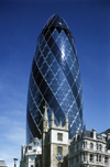 London, England: Swiss RE building, the Gherkin - 30 St Mary Axe - built by Skanska - St Andrew Undershaft Church at the bottom - photo by A.Bartel