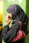 Eritrea - Asmara: Muslim girl waiting for the bus - photo by E.Petitalot