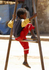 Eritrea - Keren, Anseba region: child sitting on an iron frame - photo by E.Petitalot