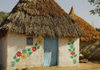 Eritrea - Hagaz, Anseba region - house decorated with floral motives - thatched roof - photo by E.Petitalot