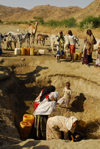 Eritrea - Hagaz, Anseba region - desert well - women drawing water - photo by E.Petitalot