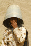 Eritrea - Senafe, Southern region: girl with a bucket on her head for sun protection - photo by E.Petitalot