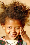 Eritrea - Mendefera, Southern region: a smilling girl - photo by E.Petitalot