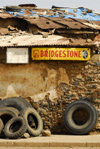 Eritrea - Mendefera, Southern region: an old tyre shop - Bridgestone sign - photo by E.Petitalot