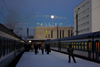 Estonia - Tallinn - Train Station - trains, snow and moon - photo by K.Hagen