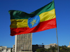 Addis Ababa, Ethiopia: Ethiopian flag and Bank of Abyssinia - Meskal square - photo by M.Torres