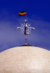 Addis Ababa, Ethiopia: St. Stephanos church - flag and cross with eggs above the dome - photo by M.Torres