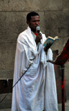 Addis Ababa, Ethiopia: St Ragueal church - priest celebrates mass outside - photo by M.Torres