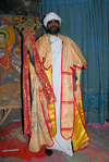 Lalibela, Amhara region, Ethiopia: Bet Maryam rock-hewn church - priest holding a cross - Ethiopian Orthodox Tewahedo Church - photo by M.Torres
