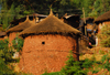 Lalibela, Amhara region, Ethiopia: cylindrical huts with thatched roofs - photo by M.Torres
