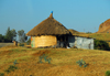 Gondar, Amhara Region, Ethiopia:hut with thatched and zinc annex - photo by M.Torres