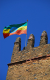 Gondar, Amhara Region, Ethiopia: Royal Enclosure - Fasiladas' Palace - Ethiopian flag on the central tower - photo by M.Torres