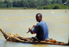 Lake Tana, Amhara, Ethiopia: fisherman at the outlet of the Blue Nile, the Abay - traditional boat - low-floating papyrus canoe, called tangwa - photo by M.Torres