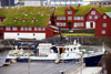 T�rshavn, Streymoy island, Faroes: ferry M/F Ritan in the east harbour ready to go to N�lsoy - government buildings in Tinganes in the background - red buildings with green sod roofs - photo by A.Ferrari
