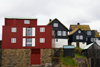 T�rshavn, Streymoy island, Faroes: red and black Faroese houses of the Tinganes peninsula - photo by A.Ferrari