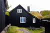 T�rshavn, Streymoy island, Faroes: bike and Faroese sod roofed houses of Tinganes - photo by A.Ferrari