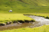Elduvik village, Eysturoy island, Faroes: small house, stream and grass fields - photo by A.Ferrari