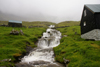 M�li, Bor�oy island, Nor�oyar, Faroes: waterfall and house in an almost abandoned village - photo by A.Ferrari