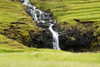 Husar, Kalsoy island, Norðoyar, Faroes: small waterfall near the village - photo by A.Ferrari