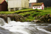 Gj�gv village, Eysturoy island, Faroes: rapids and miniature house - photo by A.Ferrari