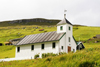 Elduvik village, Eysturoy island, Faroes: wooden church and green landscape - photo by A.Ferrari