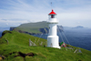 Mykinesholmur islet, Mykines island, Faroes: lighthouse at the western edge of Mykinesholmur - built in 1909, now automated - it is switched off in the summer, due to the light nights on the Faroes - photo by A.Ferrari