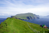 Mykinesholmur islet, Mykines island, Faroes: view over Mykines from the western edge of Mykinesholmur - the house on the left is the only one on the islet, built in 1920 for the lighthouse keeper - photo by A.Ferrari