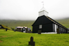 Norðragøta village, Norðragøta village, Eysturoy island, Faroes: the old wooden church in the centre of the village, built in 1833 - grave stones - photo by A.Ferrari