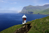 S�rv�gsfj�r�ur fjord, V�gar island, Faroes: lighthouse perched over the sea - solar power operated - photo by A.Ferrari