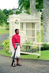 Suva, Viti Levu island, Fiji - Central Division: Guard on duty outside the Parliament building - soldier in a skirt - photo by R.Eime
