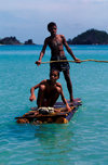 Nacula Island, Yasawa group, Fiji: pair boys on an improvised log raft near Mala Kati Village - photo by C.Lovell