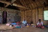 Nacula Island, Yasawa group, Ba Province, Fiji: interior of chief's house in Mala Kati Village – people on floor - bure interior - photo by C.Lovell