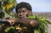 Denarau Island, Viti Levu, Fiji: male performer  covered in tree leaves - Fijian artist - photo by B.Cain