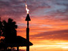 Denarau Island, Viti Levu, Fiji: torch at sunset - photo by B.Cain