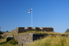 Helsinki, Finland: Finnish flag at Suomenlinna sea fortress - UNESCO World Heritage Site - photo by A.Ferrari