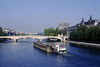 Paris, France: a tugboat pushes a barge under the Carrousel Bridge which spans the river Seine in front of the Louvre Museum - 1er arrondissement - photo by C.Lovell