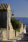 Gordes, Vaucluse, PACA, France: stone houses and street lamps – village street - photo by C.Lovell