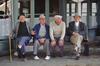 Vaucluse, PACA, France: four elderly Frenchman share a park bench - photo by C.Lovell
