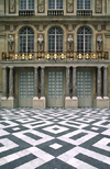 Versailles, Yvelines, Île-de-France, France: Palace of Versailles, the pleasure palace of Louis XIV, the Sun King - decorated architecture and black and white mosaics - photo by C.Lovell