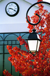 La Varenne, Val-de-Marne, Ile-de-France: clock, lamp and red leaves - photo by Y.Baby