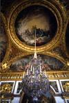 Versailles, Yvelines département, France: Palace of Versailles / Château de Versailles - Hall of Mirrors - chandelier and ceiling paintings celebrating the the reign of Louis XIV, Sun King - photo by Y.Baby