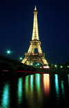 Paris: Eiffel tower - nocturnal - lights reflected on the river Seine - photo by Y.Baby