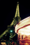 Paris: Eiffel tower and carrousel - nocturnal - photo by Y.Baby
